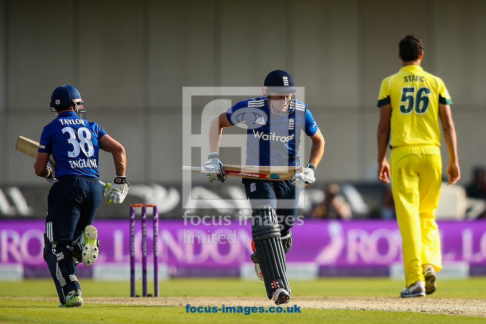 Jonny Bairstow of England (centre) sets off for a run during the 3rd One Day International match at Old Trafford Cricket Ground, Stretford<br /> Picture by Andy Kearns/Focus Images Ltd 0781 864 4264<br /> 08/09/2015