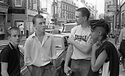 Neville, Tim Roth, Gavin and Kelly on Wardour Street, UK, 1980s.