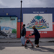 MIAMI, FLORIDA - FEBRUARY 8, 2016<br /> Morning walk to a neighborhood medical clinic in Miami's Little Haiti. Walls are painted with the Haitian flag and a memorial to the declaration of Haiti's Independence in 1804.<br /> (Photo by Angel Valentin)
