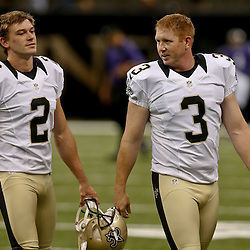 Aug 28, 2014; New Orleans, LA, USA; New Orleans Saints place kicker Derek Dimke (2) and place kicker Shayne Graham (3) talk before a preseason game against the Baltimore Ravens at Mercedes-Benz Superdome. The Ravens defeated the Saints 22-13. Mandatory Credit: Derick E. Hingle-USA TODAY Sports