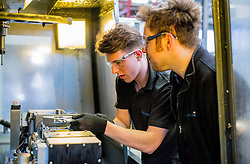 ©Licensed to i-Images Picture Agency. 27/03/2015. Apprentice Ethan fuller, 17, and Mentor Jake Williams at Warren Services, Conservative Campaign in East Anglia. Picture by Andrew Parsons / i-Images