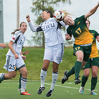 2nd year midfielder Jet Davies (17) of the Regina Cougars goes up for a header during the Women's Soccer home game on September 11 at U of R Field. Credit: Arthur Ward/Arthur Images