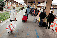 Passegners with their luggage walk towards the last Trinacria train. The Trinacria express train is a historical train from Palermo, Sicily, to Milan, symbol of the emigration from South to the North.  From December 11th 2011 16 train connecting Southern Italy to the North will be cancelled by Trenitalia, the state-owned train operator in Italy. ### I passeggeri camminano con i loro bagagli verso l'ultimo treno Trinacria. Il Trinacria è un treno storico che ha collegato Palermo e Milano, simbolo dell'emigrazione verso Nord. Dall'11 dicembre 2011 16 treni che collegano il Sud al Nord Italia verranno soppressi da Trenitalia.