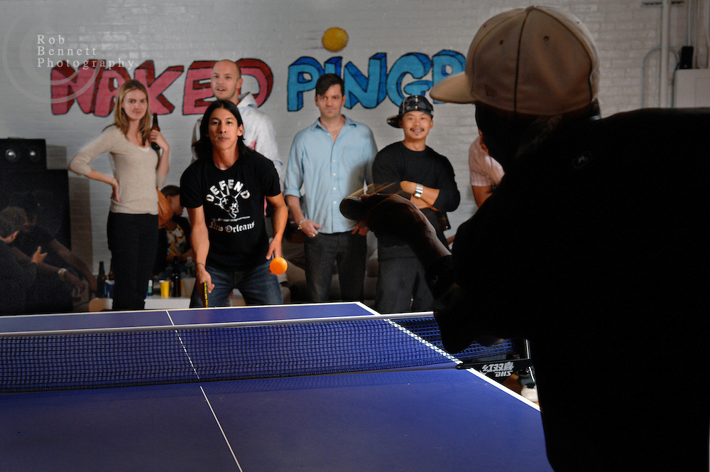 "Here, Perry Chen (facing camera) takes on Wally Green (back to camera) in a match..---.New York, NY- Friday, August 10, 2007 - ""Naked"" Ping Pong Tournament/Party-  An eclectic collection of city residents gather for a recurring Friday-night table tennis tournament/party at the Naked Ping Pong Club in the TriBeCa area of Manhattan. The founders of Naked Ping Pong are a trio of filmmakers (most recently, Naked Yoga) - Bill Mack, 34, Franck Raharinosy, 32 and Jonathan Bricklin, 30 - who claim to be training for the 2012 Olympics in London.. .Credit: Rob Bennett for The New York Times"