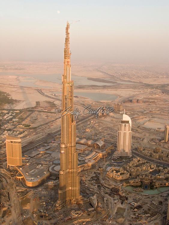 Helicopter aerial of Burj Dubai-Dubai Tower with Dubai Mall below, Dubai UEA