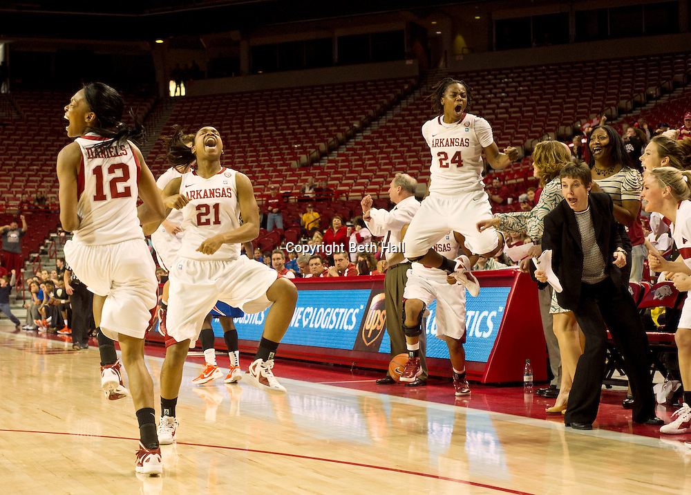 Jan 29, 2012; Fayetteville, AR, USA; Arkansas Razorbacks forwards Ashley Daniels (12) and Dominique Robinson (21) and Quistelle Williams (24) and Director of Basketball Operations Amber Shirey react to a call during game against the Florida Gators at Bud Walton Arena. Arkansas defeated Florida 73-72 in the second overtime. Mandatory Credit: Beth Hall-US PRESSWIRE