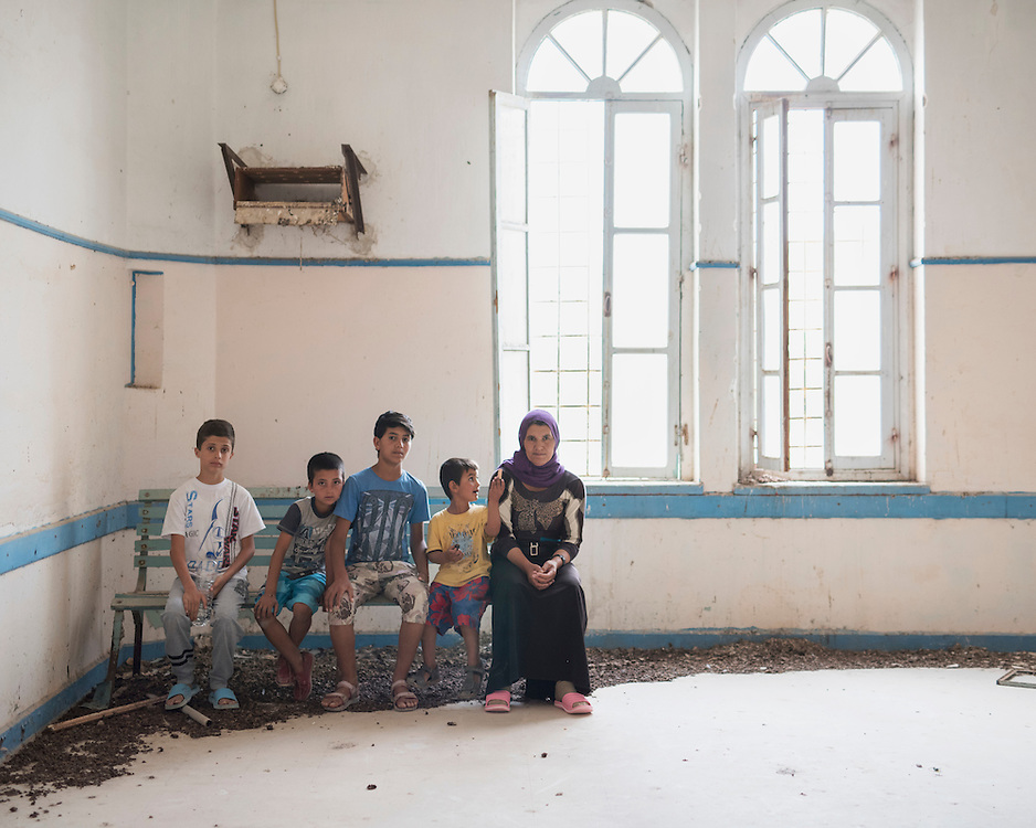 Refugees Diar, 13, Rebas, 9, Youssef, 14, Naswan, 5, and Kosh, 48, sitting in a room in the abandoned Lepida psychiatric hospital in whose grounds the Leros &lsquo;Hot spot&rsquo; (an EU-run migrant&rsquo;s reception centre)  has been built. <br />