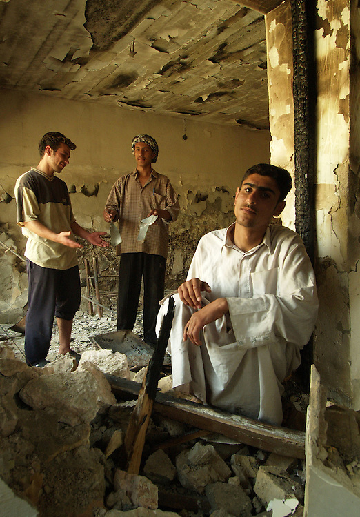 02 May 2004....Falluja, Iraq.....Aftermath of US attacks.....After being in a state of siege for almost a month and suffering devastating attacks by US aircraft and ground troops Falluja nows counts the human cost of those last few weeks.....Many homes have been completely destroyed and hundreds killed.