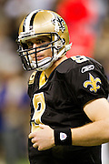 NEW ORLEANS, LA - DECEMBER 26:   Drew Brees #9 of the New Orleans Saints looks over to the sidelines during a game against the Atlanta Falcons at Mercedes-Benz Superdome on December 26, 2011 in New Orleans, Louisiana.  The Saints defeated the Falcons 45-16.  (Photo by Wesley Hitt/Getty Images) *** Local Caption *** Drew Brees
