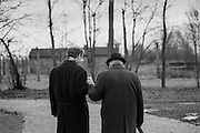 A young man is helping a survivor of the Auschwitz (Birkenau) Nazi concentration camp after the ceremony to remember the 50th anniversary of the liberation in 1995. It is estimated that between 1.1 and 1.5 million Jews, Poles, Roma and others were killed here in the Holocaust between 1940-1945.