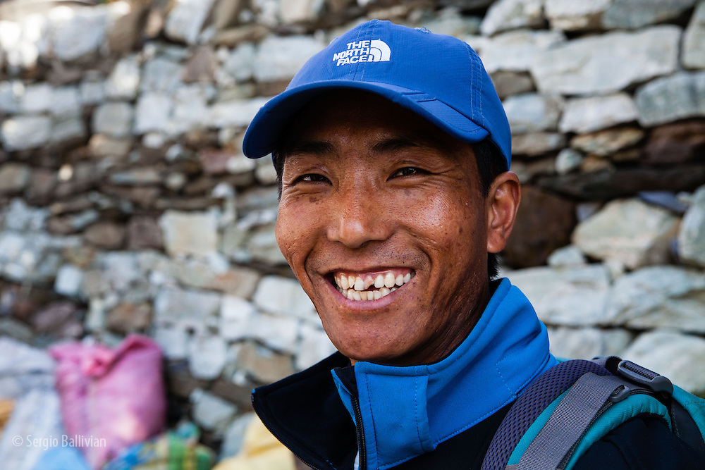 Lamababu Sherpa, an experienced trekking guide in the Annapurna Region, smiles during a conversation in Nepal.