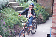 Neville on Edwards bike in Hawthorne Road, High Wycombe, UK, 1980s