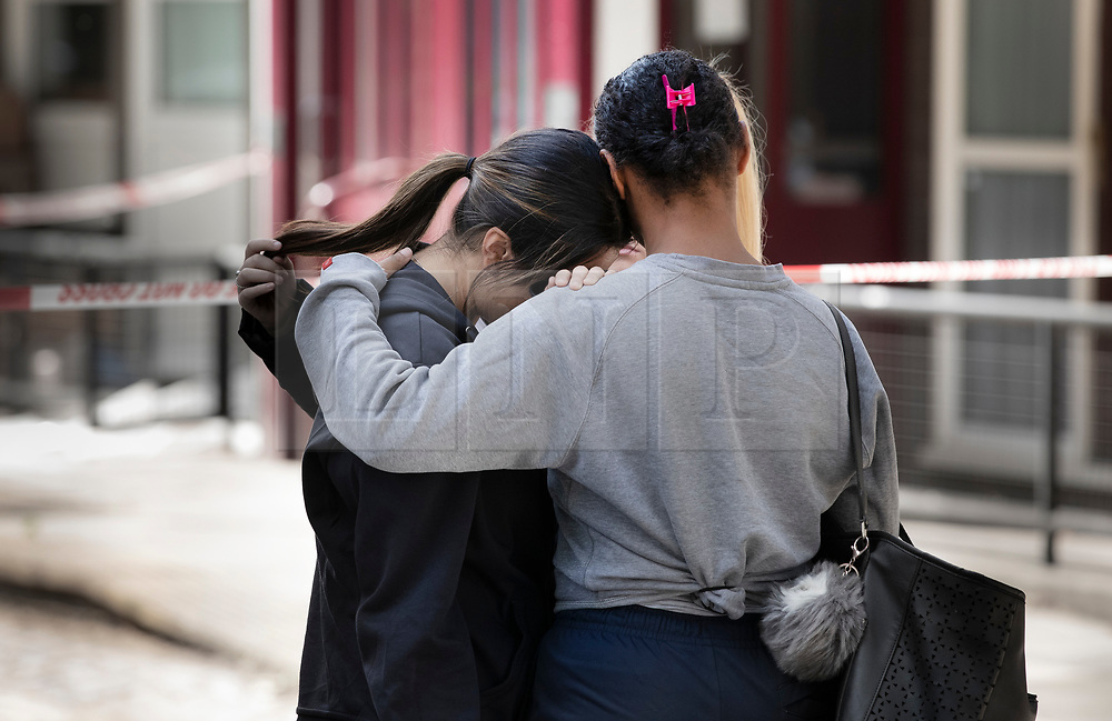 © Licensed to London News Pictures. 13/08/2019. London, UK. A group of young women console each other at the crime scene in Munster Square Camden where a male was stabbed to death last night. The victim, whose age has not yet been released, was pronounced dead at the scene after police were called shortly after 11pm. Photo credit: Peter Macdiarmid/LNP