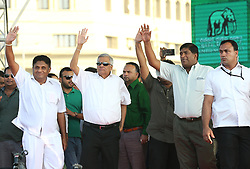 December 17, 2018 - Sri Lanka - Sri Lanka's reinstated prime minister Ranil Wickremesinghe, center, waves to his supporters during a rally in Colombo, Sri Lanka, Monday, December 17, 2018. (Credit Image: © Pradeep Dambarage/Pacific Press via ZUMA Wire)