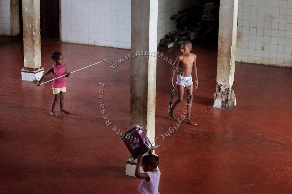 Children are playing inside the old hospital of Roça Agostinho Neto, where they now live with their families, on the island of Sao Tome, Sao Tome and Principe, (STP) a former Portuguese colony in the Gulf of Guinea, West Africa.
