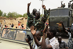 59722708.Soldiers wave to residents after returning from battlefield, in El Rahad of Sudan's North Kordofan State May 28, 2013. Sudanese army announced on Monday that it has liberated the strategic area of Abu Karshula in South Kordofan State from rebels of the Revolutionary Front. May 28, 2013..UK ONLY