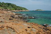 Rocky shore in low tide at Isla Pacheca shore. Las Perlas Archipelago, Panama Province, Panama, Central America.