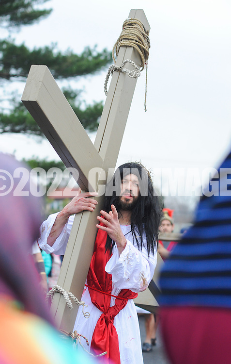 Roberto Marquez, of Bensalem, Pennsylvania portrays Jesus as he meets the women of Jerusalem during the Stations of the Cross leading to his crucifixion on Good Friday April 3, 2015 at Our Lady of Fatima in Bensalem, Pennsylvania.  (Photo by William Thomas Cain/Cain Images)