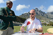 CAPE TOWN, South Africa, Thursday 30 August 2012, Matthew Booth, former South African player and now defender of Ajax Cape Town football team, signed official posters for learners at Camps Bay High School. Ajax Cape Town visits schools regularly to speak to learners at schools as well as hold coaching clinics..Photo Roger Sedres/ Image SA