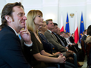 (L) Famous actor Pawel Wilczak & (R) famous actress Joanna Brodzik with athletes of Special Olympics attend a meeting with First Lady Anna Komorowska in Presidential Palace in Warsaw on February 26, 2013..The mission of Special Olympics is to provide sports training and athletic competition for children and adults with intellectual disabilities...Poland, Warsaw, February 26, 2013..Picture also available in RAW (NEF) or TIFF format on special request...For editorial use only. Any commercial or promotional use requires permission...Photo by © Adam Nurkiewicz / Mediasport