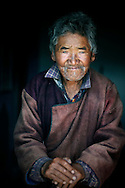 India, Ladakh. Portrait of a 79-years old man from Spangmik, a little himalayan village at Pangong Tso.