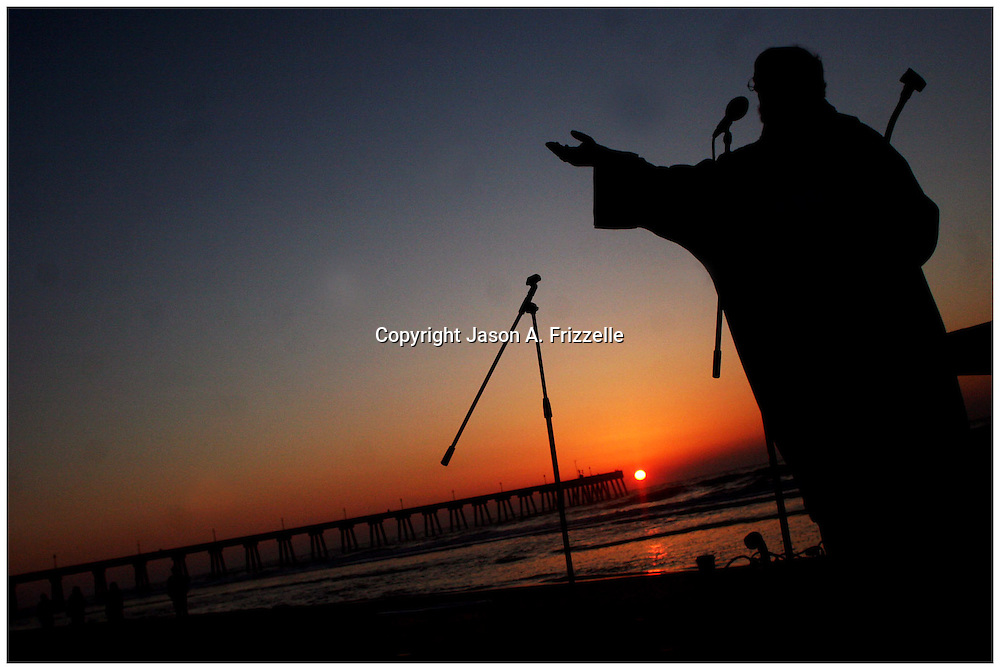 The Rev. Richard G. Elliott, III of St. Andrews on the Sound Episcopal Church gives a sermon Sunday during the Wrightsville Beach Community Sunrise Service at Wrightsville Beach. The combined Easter sevice consisted of the six churches of Wrightsville Beach.   (Jason A. Frizzelle)