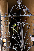 A wrought iron gate at a home on Queen Street in historic Charleston, SC.