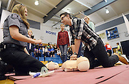 From left, Melissa Norton gives directions to Trent Post of Medford, New Jersey as she explains CPR during the Deborah Heart and Lung's screenings for possible conditions leading to sudden cardiac arrest Saturday April 30, 2016 at Northern Burlington High School in Mansfield Township, New Jersey.  (Photo by William Thomas Cain)