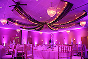 Wedding reception uplighting by Jimmie Malone and Exceptional Receptions in shades of purple and pink at the Owego Treadway Inn, Owego, NY