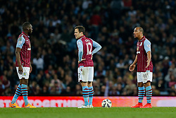 Joe Cole and Gabriel Agbonlahor of Aston Villa look dejected after Charlie Austin of QPR (not pictured) scores a goal to make it 2-3 - Photo mandatory by-line: Rogan Thomson/JMP - 07966 386802 - 07/04/2015 - SPORT - FOOTBALL - Birmingham, England - Villa Park - Aston Villa v Queens Park Rangers - Barclays Premier League.