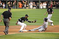 CHICAGO - JUNE 04:  Alexei Ramirez #10 of the Chicago White Sox applies a late tag to the sliding Austin Jackson #14 of the Detroit Tigers as Jackson steals second base on June 4, 2011 at U.S. Cellular Field in Chicago, Illinois.  The Tigers defeated the White Sox 4-2.  (Photo by Ron Vesely)  Subject:   Alexei Ramirez;Austin Jackson