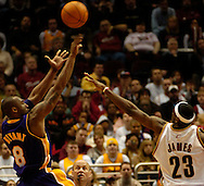 PHOTO BY DAVID RICHARD.Kobe Bryant makes a shot over the defense of LeBron James March 19 in Cleveland.