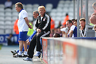 Loftus Road, London - Saturday 11th September 2010: Gordon Strachan, manager of Middlesborough sits on the barriers as his team lose 3-0 in the Npower Championship match between Queens Park Rangers and Middlesborough. (Photo by Andrew Tobin/Focus Images)
