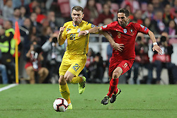 March 22, 2019 - Lisbon, Portugal - Oleksandr Karavaev of Ukraine (L) vies for the ball with João Moutinho of Portugal (R) during the Qualifiers - Group B to Euro 2020 football match between Portugal vs Ukraine. (Credit Image: © David Martins/SOPA Images via ZUMA Wire)