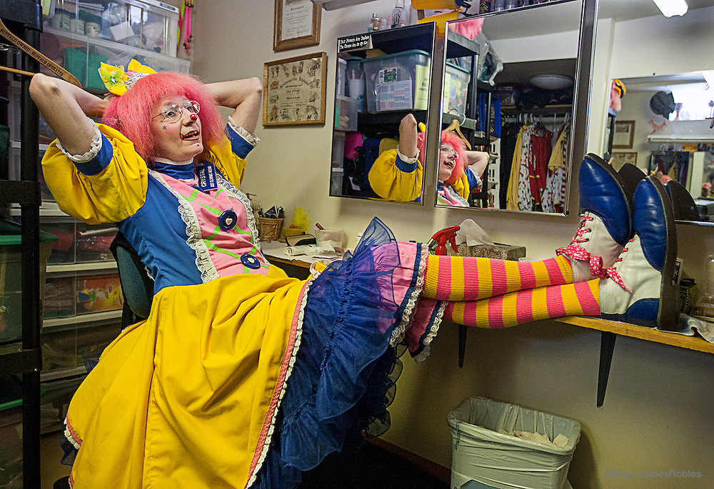 "Raised in a rural community south of Buffalo, N.Y., Cindy was a medical transcriptionist until a shy co-worker asked her to take some clown classes with her. ""I was an enabler and went to classes with her,"" she said. Her co-worker soon dropped out but she stayed with it. ""We wear clown shoes that are made of leather and the toes are stuffed with horse hair; horse hair when it gets we doesn't rot,"" Cindy said describing her gargantuan shoes that always get stares and questions from short people like children."