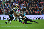 Buffalo Bills Percy Harvin getting tackled by two players during the Buffalo Bills v Jacksonville Jaguars NFL International Series match at Wembley Stadium, London, England on 25 October 2015. Photo by Matthew Redman.