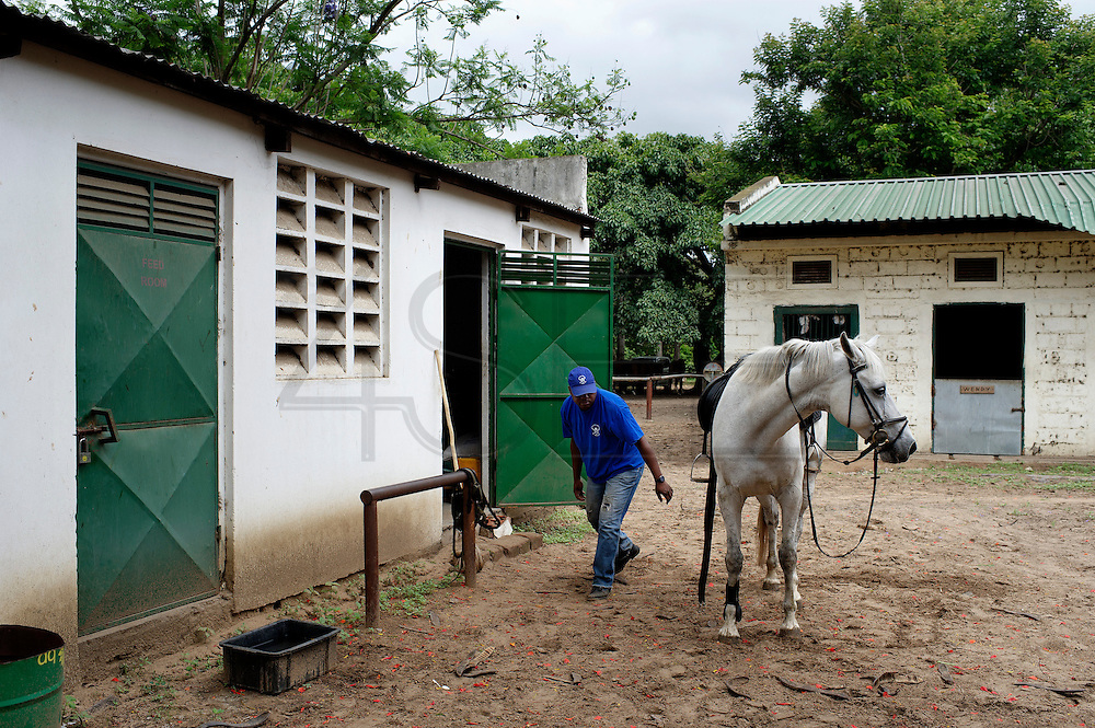 The equestrian centre of Maputo was born in the 1950 during the Portuguese Colonial time. Considered for years one of the most important place of the sub- Saharan Africa for the dressage it resisted to the colonial war and to the Mozambique civil war, his decadence started after the civil war when a poisoned batch of horse food killed most of the animal. Today the centre is trying to resume his old glory living between the past and an uncertain future. Mr Silva, the main teacher of the centre after his personal training.