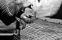 Pescatori in città vecchia - la riparazione delle reti