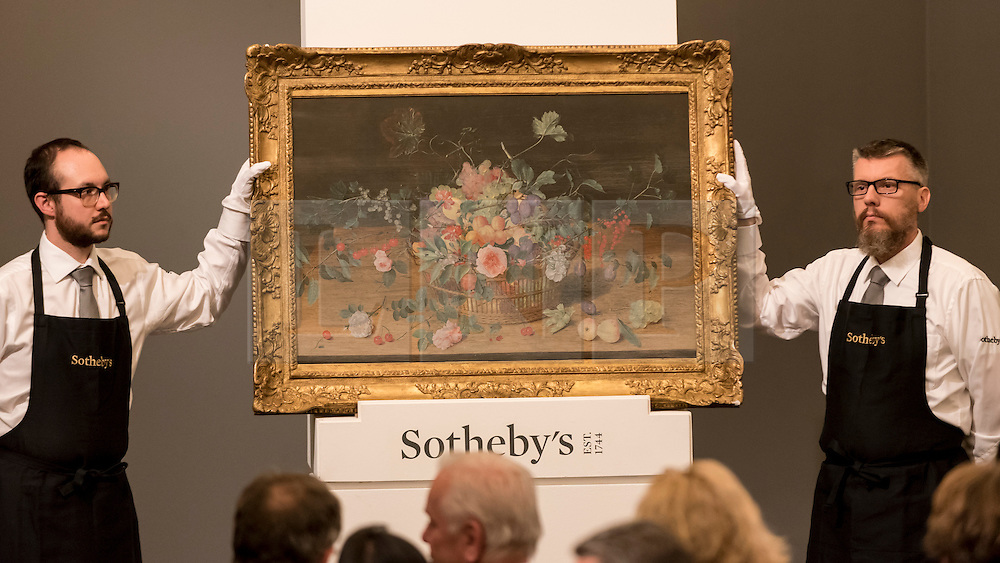 """© Licensed to London News Pictures. 06/07/2016. London, UK.  """"Still life with a basket of flowers and fruit"""" by Isaak Soreau, which sold for a hammer price of GBP 0.19m (est GBP 0.15-0.2m) at Sotheby's Old Masters evening sale in New Bond Street. Photo credit : Stephen Chung/LNP"""