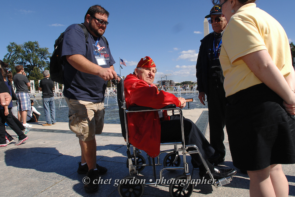 WWII Veteran Marine Nunzio Franchi (center) at the WWII Memorial in Washington, DC on Saturday, October 18, 2014. Seventy-five WWII Veterans from the Westchester County area toured the WWII Memorial and Arlington National Cemetery onboard the inaugural flight from Westchester County Airport in White Plains, NY. Hudson Valley Honor Flight is a chapter of the Honor Flight Network, which provides free flights for WWII Veterans and tours of the WWII Memorial constructed in their honor, and other sites in the nation's capital.  © www.chetgordon.com