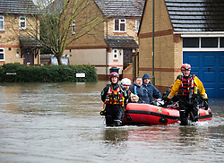 Pensioner June Shanks is evacuated from her house in Egham, Surrey by the emergency rescue services, Surrey, United Kingdom, Wednesday 12th February 2014. Picture by David Dyson / i-Images