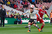 Fulham striker Ross McCormack clears the ball under pressure from Middlesbrough FC midfielder Adam Clayton during the Sky Bet Championship match between Middlesbrough and Fulham at the Riverside Stadium, Middlesbrough, England on 17 October 2015. Photo by George Ledger.