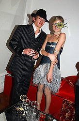 LADY ELOISE ANSON and MR JACOBI ANSTRUTHER-GOUGH-CALTHORPE at Andy & Patti Wong's Chinese New Year party to celebrate the year of the Rooster held at the Great Eastern Hotel, Liverpool Street, London on 29th January 2005.  Guests were invited to dress in 1920's Shanghai fashion.<br />