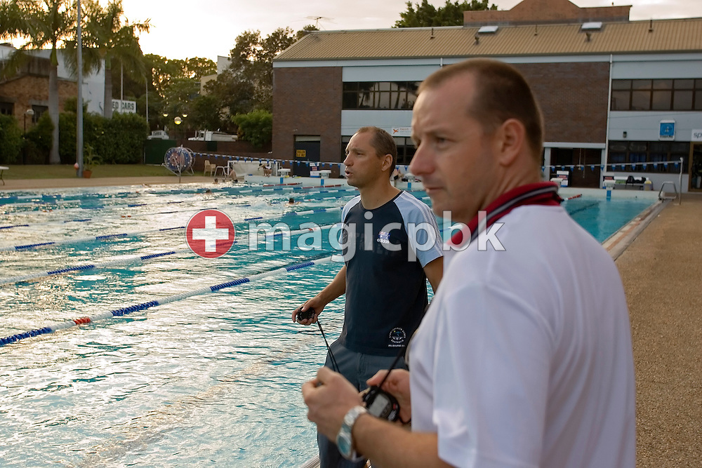 Australian-based coach Stephan Widmer (L) of Switzerland and his assistant Brant BEST (R) of Australia are pictured during a training session in the Valley Swimming Pool in Fortitude Valley, Brisbane, Australia, Monday, March 12, 2007. (Photo by Patrick B. Kraemer / MAGICPBK)