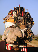 Overcharged truck on the paved road to Douentza, central Malian region.