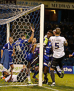 Gillingham FC midfielder Emmanuel Osadebe (scorer of Gillingham's 3rd goal, gets a boot the the chin while involved with a goalie scrap deep in to the second half during the Sky Bet League 1 match between Gillingham and Bury at the MEMS Priestfield Stadium, Gillingham, England on 14 November 2015. Photo by Andy Walter.