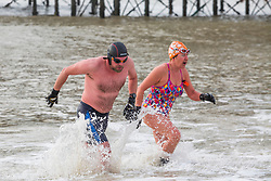 © Licensed to London News Pictures. 06/01/2018. Brighton, UK. Members of the Brighton Swimming Club brave the cold water temperatures to go for their daily exercise. Photo credit: Hugo Michiels/LNP