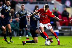 Jamie Paterson of Bristol City is tackled by Jordan Williams of Barnsley - Rogan/JMP - 18/01/2020 - Ashton Gate Stadium - Bristol, England - Bristol City v Barnsley - Sky Bet Championship.