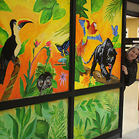 JOHN WARD/BUY AT PHOTOS.MONROECOUNTYJOURNAL.COM<br /> Amory Middle School Teacher of the Year Nan Moon peaks around a glass mural she painted at the school.