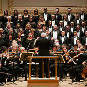"""March 6, 2012 - New York, NY : .Guest conductor Jon Oliver, standing in foreground, leads the Boston Symphony Orchestra featuring the Tanglewood Festival Chorus in Ludwig Van Beethoven's """"Missa solemnis in D Major, Op. 123 (1819-1823)' in Isaac Stern Auditorium at Carnegie Hall on Tuesday night..CREDIT : Karsten Moran for The New York Times"""